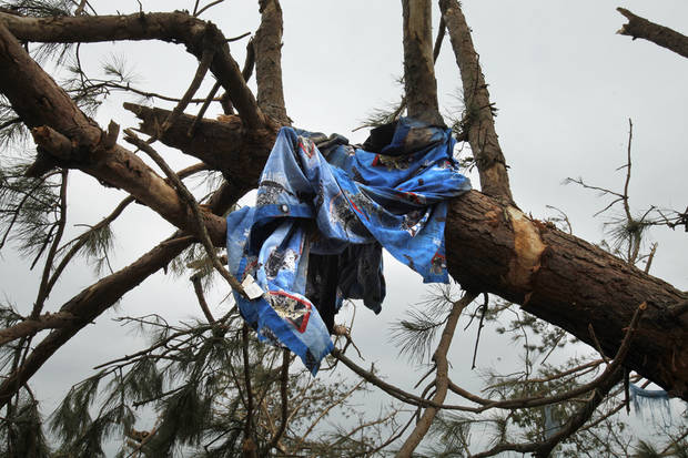 A child's blanket is caught in a tree on the hillside north of Highway 9 near SE 192 on Wednesday, May 12, 2010, in Norman, Okla.   A mother died and her children were injured at this location during Monday's severe storms.  Photo by Steve Sisney, The Oklahoman