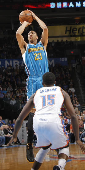 New Orleans Hornets' Anthony Davis (23) shoots over Oklahoma City Thunder's Reggie Jackson (15) during the NBA basketball game between the Oklahoma CIty Thunder and the New Orleans Hornets at the Chesapeake Energy Arena on Wednesday, Dec. 12, 2012, in Oklahoma City, Okla.   Photo by Chris Landsberger, The Oklahoman