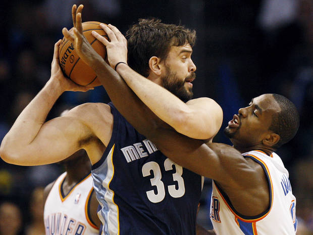 Oklahoma City's Serge Ibaka (9) defends Memphis' Marc Gasol (33) during an NBA basketball game between the Oklahoma City Thunder and the Memphis Grizzlies at Chesapeake Energy Arena in Oklahoma City, Monday, Feb. 3, 2014. Oklahoma City won, 86-77. Photo by Nate Billings, The Oklahoman