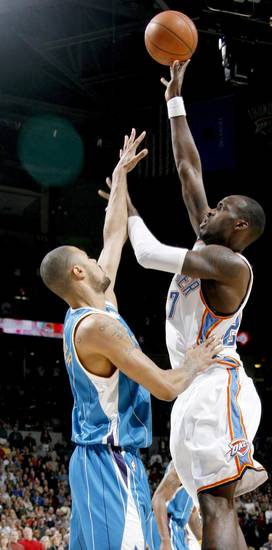 Oklahoma City's Johan Petro shoots the ball over Tyson Chandler of New Orleans during the NBA basketball game between the Oklahoma City Thunder and the New Orleans Hornets at the Ford Center in Oklahoma City on Friday, Nov. 21, 2008.   BY BRYAN TERRY, THE OKLAHOMAN