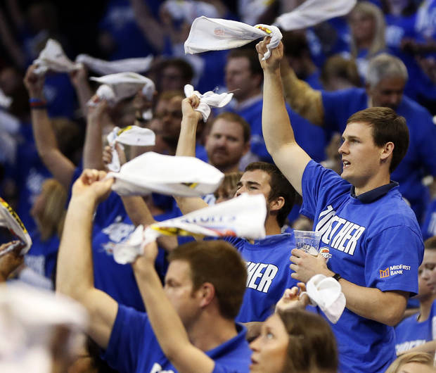 Thunder fans swing towels during Game 1 in the first round of the NBA playoffs between the Oklahoma City Thunder and the Houston Rockets at Chesapeake Energy Arena in Oklahoma City, Sunday, April 21, 2013. Photo by Nate Billings, The Oklahoman