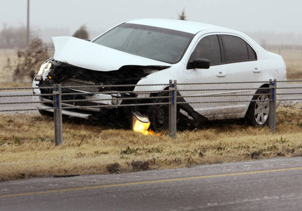Highway patrol and emergency personnel responded to several accidents on Interstate 35 between Johnson Road and the Goldsby exit at around 9 a.m. as rain, sleet, high winds and freezing temperatures moved into the area on Thursday, Dec. 24, 2009, near Norman, Okla.   Photo by Steve Sisney, The Oklahoman
