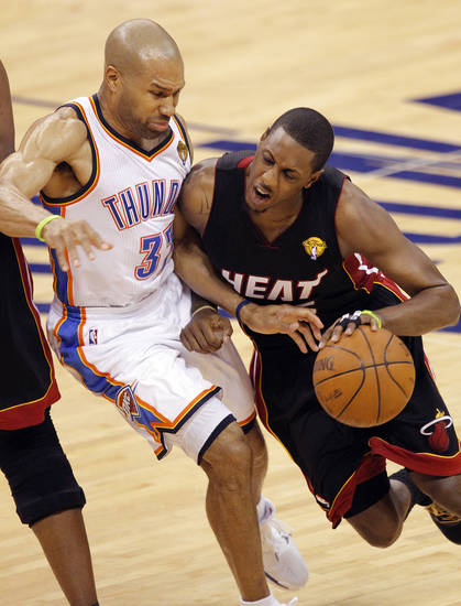 Miami's Mario Chalmers (15) drives past Oklahoma City's Derek Fisher (37) during Game 2 of the NBA Finals between the Oklahoma City Thunder and the Miami Heat at Chesapeake Energy Arena in Oklahoma City, Thursday, June 14, 2012. Photo by Chris Landsberger, The Oklahoman