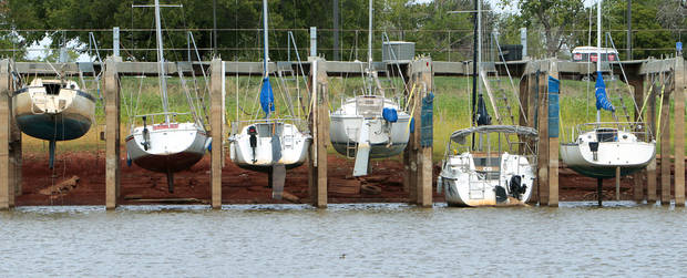Sailboats hang from their wet slips at Lake Hefner, Monday, September 24, 2012. Photo By David McDaniel
