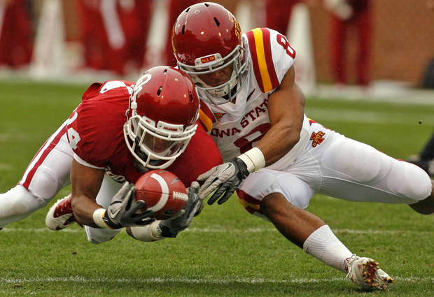 Oklahoma's Aaron Colvin (14) recovers  a fumble by Iowa State's James White (8) during a college football game between the University of Oklahoma Sooners (OU) and the Iowa State University Cyclones (ISU) at Gaylord Family-Oklahoma Memorial Stadium in Norman, Okla., Saturday, Nov. 26, 2011. Photo by Steve Sinsey, The Oklahoman