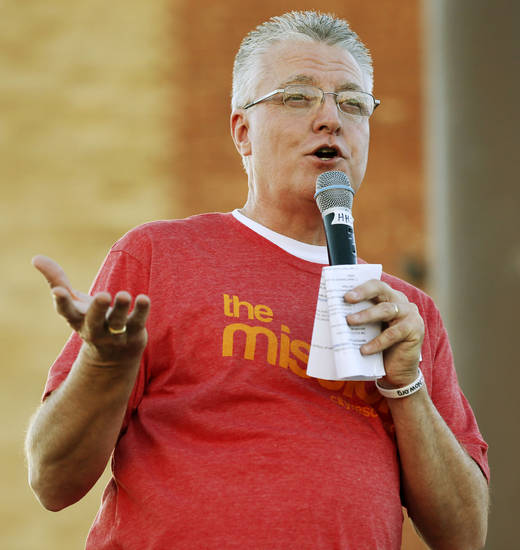 The Rev. Tom Jones, president and chief executive officer of City Rescue Mission, speaks Monday during a street party to launch the shelter's FeedOKCNow initiative in downtown Oklahoma City. <strong>NATE BILLINGS - NATE BILLINGS</strong>