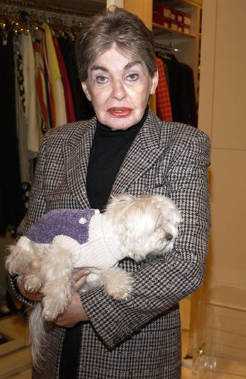 Leona Helmsley holds her dog Trouble in 2003.  AP FILE PHOTO