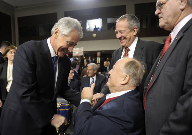 Former Nebraska Republican Sen. Chuck Hagel, left, President Barack Obama's choice for defense secretary, greets former Georgia Sin. Max Cleland, center, after arriving on Capitol Hill in Washington,  Thursday, Jan. 31, 2013, to testify before the Senate Armed Services Committee hearing on his nomination.  (AP Photo/Susan Walsh)