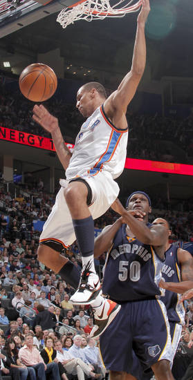 Oklahoma City's Thabo Sefolosha dunks the ball over Zach Randolph of Memphis during the NBA basketball game between the Oklahoma City Thunder and the Memphis Grizzlies at the Ford Center in Oklahoma City on Wednesday, April 14, 2010. 