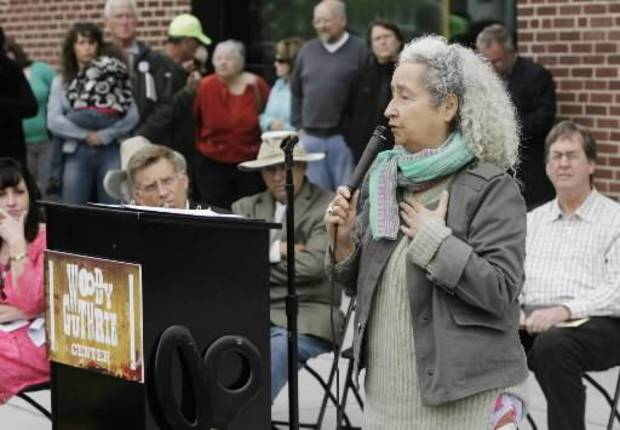 The daughter of Woody Guthrie, Nora Guthrie speaks during a ribbon-cutting ceremony for the Woody Guthrie Center Saturday, April 27, 2013 in Tulsa, Okla.  AP Photo/Tulsa World, James Gibbard