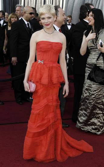 Michelle Williams arrives before the 84th Academy Awards on Sunday, Feb. 26, 2012, in the Hollywood section of Los Angeles. (AP Photo/Matt Sayles) ORG XMIT: OSC159
