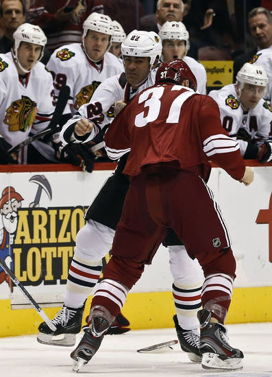 Phoenix Coyotes&#039; Raffi Torres (37) fights with Chicago Blackhawks&#039; Jamal Mayers (22) during the first period in an NHL hockey game Thursday, Feb. 7, 2013, in Glendale, Ariz.(AP Photo/Ross D. Franklin)