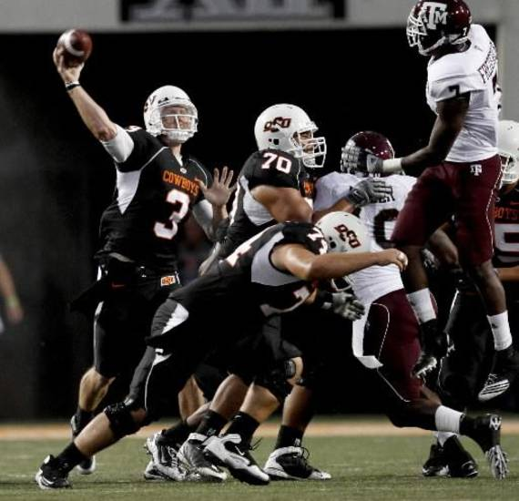 Brandon Weeden says last year's A&amp;amp;M win &quot;catapulted&quot; the Cowboys.