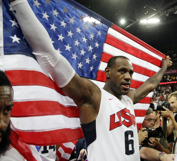 United States' LeBron James celebrates after the men's gold medal basketball game at the 2012 Summer Olympics, Sunday, Aug. 12, 2012, in London. USA won 107-100. (AP Photo/Eric Gay)