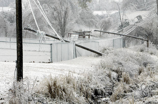 Power poles lay over fences on Friday, Jan. 29, 2010, in Purcell, Okla. after a winter storm.  Photo by Steve Sisney, The Oklahoman