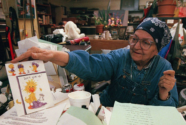 """Sister"" Ruth Wynne, co-founder of the Jesus House, sits among mounds of papers, some of which offer encouragement, in this 1996 photo. <strong>STEVE SISNEY</strong>"