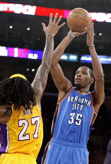 Oklahoma City's Kevin Durant (35) shoots over Los Angeles' Jordan Hill (27) during Game 4 in the second round of the NBA basketball playoffs between the L.A. Lakers and the Oklahoma City Thunder at the Staples Center in Los Angeles, Saturday, May 19, 2012. Photo by Nate Billings, The Oklahoman