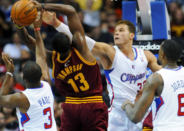 Los Angeles Clippers forward Blake Griffin (32) and guard Chris Paul (3) defend Cleveland Cavaliers forward Tristan Thompson (13) during the first half of an NBA basketball game, Monday, Nov. 5, 2012, in Los Angeles. (AP Photo/Gus Ruelas)
