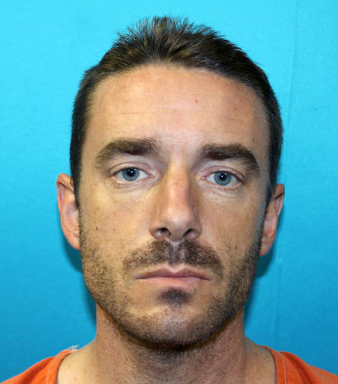 "This handout photo provided by the Richland Hills Police Department shows Brent Troy Bartel. Richland Hills, Texas.  Police said Bartel carved a pentagram into his 6-year-old son�s back Wednesday, telling a 911 dispatcher that he did it because �it�s a holy day.""  Brent Troy Bartel was charged with aggravated assault with a deadly weapon.  (AP Photo/Richland Hills Police Department)"