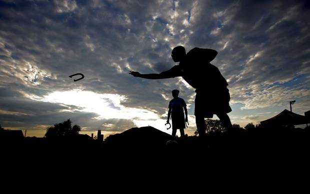 Dennis Portis, front, plays a game of horse shoes with Dianne McDaniel during a Neighbors Night Out event for the John F. Kennedy neighborhood in Oklahoma City, Saturday, Sept. 10. 2011. Photo by Bryan Terry, The Oklahoman ORG XMIT: KOD