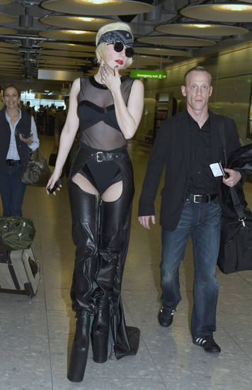 US singer Lady Gaga arrives at Heathrow Airport from the US, Wednesday, June 23, 2010. (AP Photo)  ** UNITED KINGDOM OUT NO SALES NO INTERNET NO ONLINE NO MAGS  **  ORG XMIT: LON817
