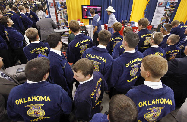 A large group gathers around the booth sponsored by the Tulsa Welding School to watch fellow FFA members try welding during the annual state convention of FFA members at the Cox Convention Center in Oklahoma City. Photos by Jim Beckel, The Oklahoman