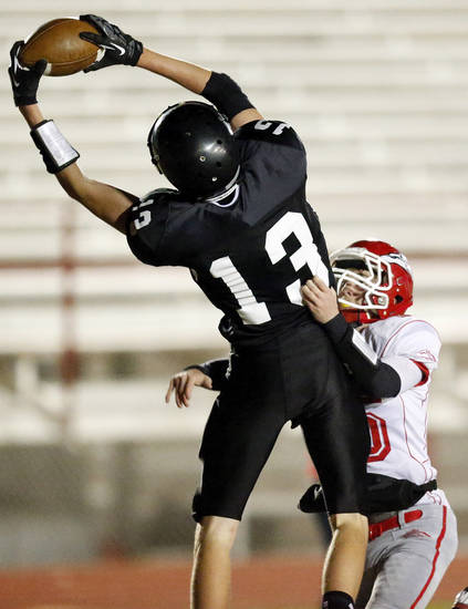Zach Rayner (13) catches a touchdown pass for Pond Creek-Hunter as Taylor Townsend (15) defends for Fox during a Class B semifinal high school football playoff game between Pond Creek-Hunter and Fox in Del City, Friday, Nov. 23, 2012. Photo by Nate Billings, The Oklahoman