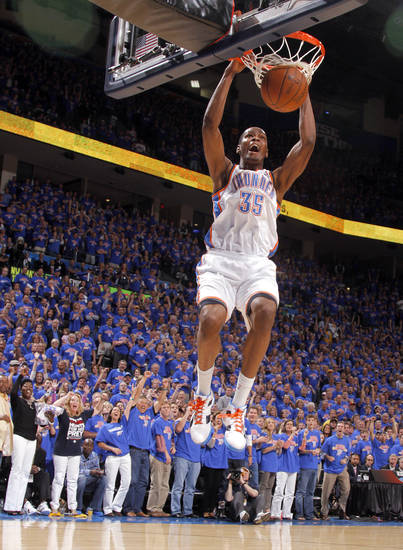Oklahoma City's Kevin Durant (35) dunks the ball in the fourth quarter during game 7 of the NBA basketball Western Conference semifinals between the Memphis Grizzlies and the Oklahoma City Thunder at the OKC Arena in Oklahoma City, Sunday, May 15, 2011. Photo by Sarah Phipps, The Oklahoman