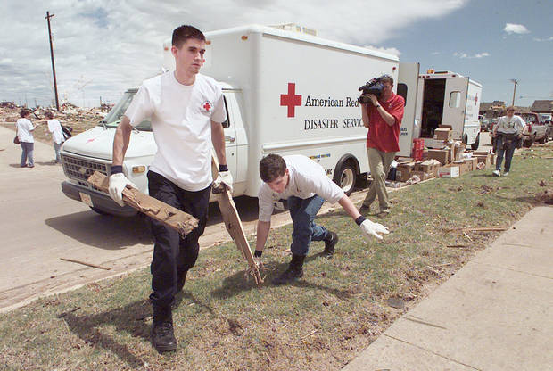 MAY 3, 1999 TORNADO: NORMAN RED CROSS VOLUNTEERS JASON AND BRENT CLEAR AN AREA FOR FOOD AND WATER FOR MOORE RESIDENTS NEAR WEST MOORE HIGH SCHOOL