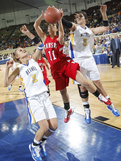 CLASS 3A GIRLS HIGH SCHOOL BASKETBALL / STATE TOURNAMENT: Kansas' Courtney Cowan (11) drives to the basket through Bethel's Kylee Tatum (2) and Taylor Cooper (3) during the championship game of the 3A girls state championship tournament at the Big House in the State Fair Park on Saturday, March 12, 2011, in Oklahoma City, Okla.   Photo by Chris Landsberger, The Oklahoman ORG XMIT: KOD