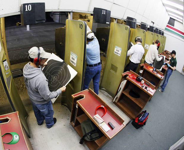 Participants check their targets after firing their handguns on a gun range during a concealed-carry class at H&H Gun Range and Shooting Sports Complex in Oklahoma City, Wednesday, Jan. 23, 2013. Photo by Nate Billings, The Oklahoman