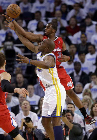 Los Angeles Clippers' Chris Paul (3) defends a high pass intended for Golden State Warriors' Carl Landry, bottom, during the first half of an NBA basketball game in Oakland, Calif., Wednesday, Jan. 2, 2013. (AP Photo/Marcio Jose Sanchez)