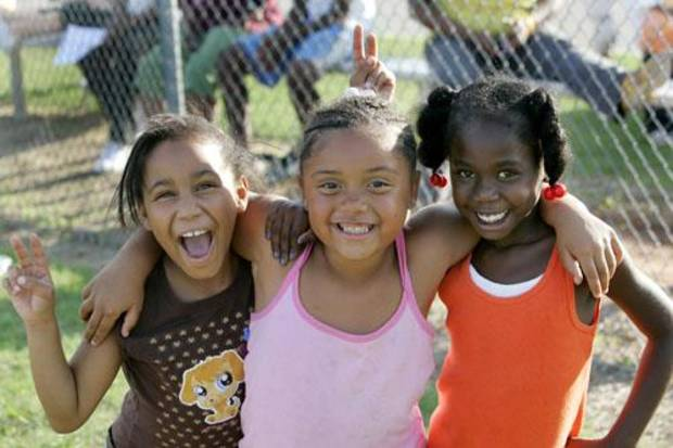 Girls at a youth football practice at Millwood school pose for a picture.