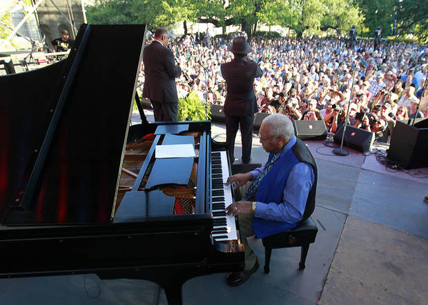 Pianist Ellis Marsalis performs with Kermit Ruffins and Dr. Michael White, left, at a sunrise concert marking International Jazz Day in New Orleans, Monday, April 30, 2012. The performance, at Congo Square near the French Quarter, is one of two in the United States Monday; the other is in the evening in New York. Thousands of people across the globe are expected to participate in International Jazz Day, including events in Belgium, France, Brazil, Algeria and Russia. (AP Photo/Gerald Herbert)