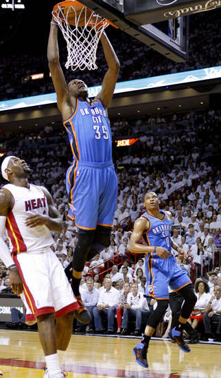 Oklahoma City's Kevin Durant (35) dunks the ball in front of Miami's LeBron James (6) during Game 4 of the NBA Finals between the Oklahoma City Thunder and the Miami Heat at American Airlines Arena, Tuesday, June 19, 2012. Photo by Bryan Terry, The Oklahoman