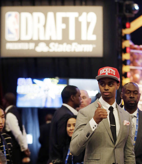 Connecticut's Jeremy Lamb gestures moments after being selected No. 12 by the Houston Rockets during the NBA basketball draft, Thursday, June 28, 2012, in Newark, N.J. (AP Photo/Julio Cortez) ORG XMIT: NJJC120