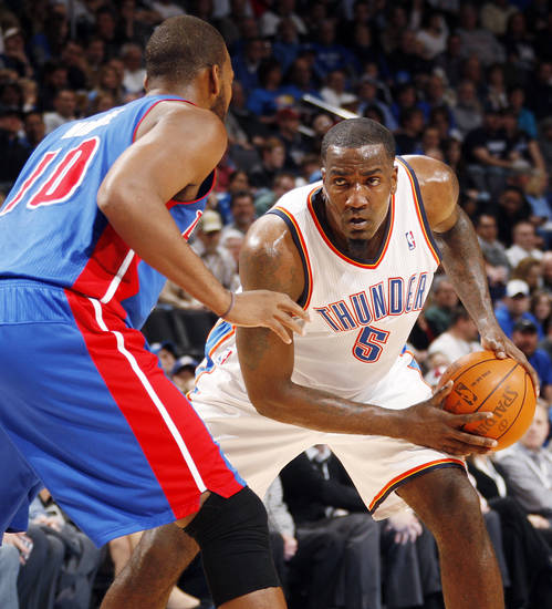 Oklahoma City's Kendrick Perkins (5) looks to get the ball past Greg Monroe (10) of Detroit during the NBA basketball game between the Detroit Pistons and Oklahoma City Thunder at the Chesapeake Energy Arena in Oklahoma City, Monday, Jan. 23, 2012. Photo by Nate Billings, The Oklahoman
