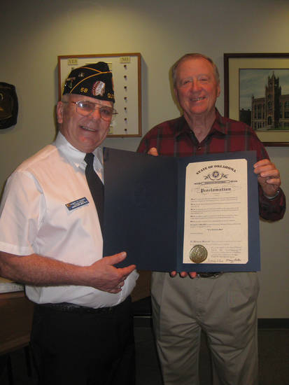 Albert Hawkes, left, American Legion Post 58 commander, presents Guthrie Mayor Chuck Burtcher the governor�s proclamation recognizing Guthrie as the official �89er celebration city of Oklahoma. PHOTO PROVIDED