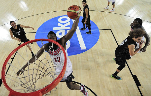 James Harden of the U.S dunks against New Zealand during the Group C Basketball World Cup match, in Bilbao northern Spain, Tuesday, Sept. 2, 2014. The 2014 Basketball World Cup competition take place in various cities in Spain from  last Aug. 30 through to Sept. 14. (AP Photo/Alvaro Barrientos)