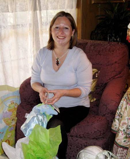 COMING SOON....Jennie MacKellar Lewis opens packages at the baby  shower given by Janie Axton, Barbara Beeler, Sue Goodman, Jayne  Henline and Linda Reece in the Axton home. (Photo by Helen Ford   Wallace).