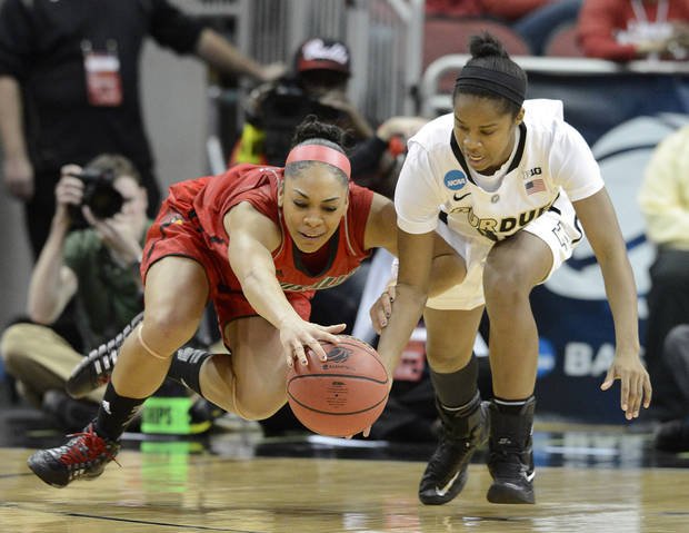 Louisville's Bria Smith, left, battles Purdue's April Wilson for a loose ball during the second half of their second round game in the women's NCAA college basketball tournament in Louisville, Ky., Tuesday March 26, 2013. Louisville defeated Purdue 76-63. (AP Photo/Timothy D. Easley)