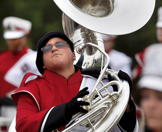 Sophomore Jacob Brumley  is animated as he carries his sousaphone while marching with the band.  Carl Albert High School is celebrating its 50th birthday this year and students and alumni participated in homecoming week activities, including a two-mile long parade before the football game on Friday, Oct. 12, 2012.    Photo by Jim Beckel, The Oklahoman