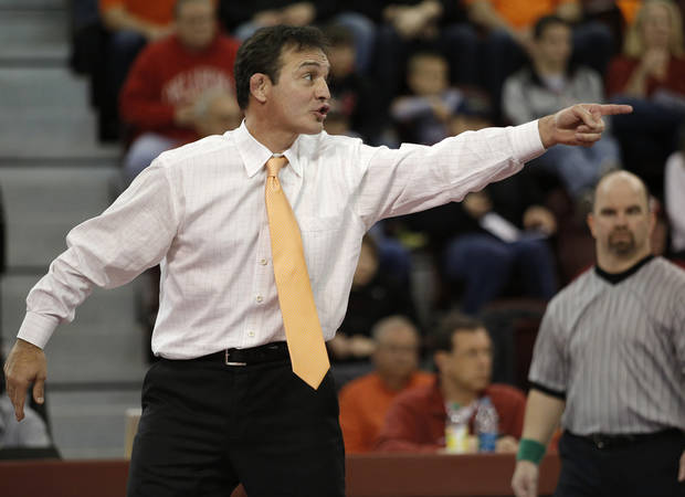 OSU head coach John Smith yells from the bench during the wrestling match between Oklahoma University and Oklahoma State University at McCasland Field House in Norman, Okla.,Sunday, Dec. 9, 2012.  Photo by Garett Fisbeck, For The Oklahoman