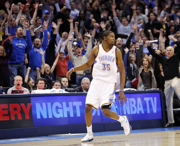 Oklahoma City fans react after Kevin Durant (35) hit the game-winning shot as time expired in an NBA basketball game between the Oklahoma City Thunder and the Dallas Mavericks at Chesapeake Energy Arena in Oklahoma City, Thursday, Dec. 29, 2011. Oklahoma City won, 104-102. Photo by Nate Billings, The Oklahoman