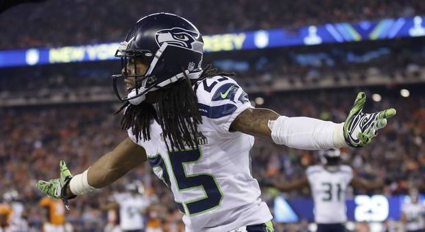 Richard Sherman celebrates during Super Bowl 48 last February. Sherman and the Seahawks are favored to return to Super Bowl 49. (AP Photo)