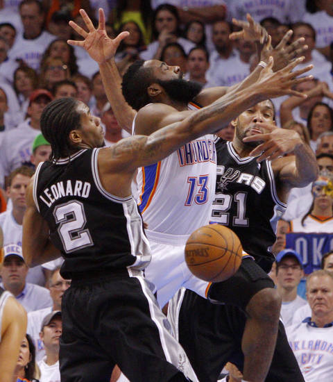 Oklahoma City's James Harden (13) loses the ball between San Antonio's Kawhi Leonard (2) and Tim Duncan (21) during Game 6 of the Western Conference Finals between the Oklahoma City Thunder and the San Antonio Spurs in the NBA playoffs at the Chesapeake Energy Arena in Oklahoma City, Wednesday, June 6, 2012. Photo by Bryan Terry, The Oklahoman