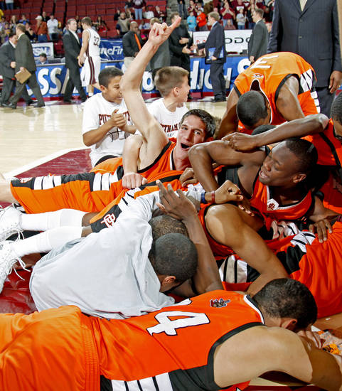 The Putnam City team celebrates after winning the Class 6A boys championship game between Putnam City and Jenks in the Oklahoma High School Basketball Championships at Lloyd Noble Arena in Norman, Okla., Saturday, March 14, 2009. PHOTO BY BRYAN TERRY, THE OKLAHOMAN