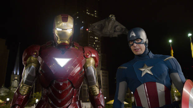"FILE - In this file photo of a publicity film image released by Disney, Iron Man, portrayed by Robert Downey Jr., left, and Captain America, portrayed by Chris Evans, are shown in a scene from ""The Avengers.""  (AP Photo/Disney, File)"