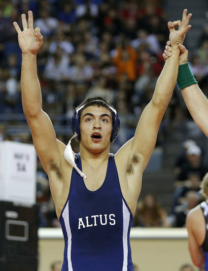 Keilan Torres of Altus celebrates after beating Chad Draper of Deer Creek, behind, during the Class 5A 160-pound championship match during the state wrestling championships at the State Fair Arena in Oklahoma City, Saturday, Feb. 23, 2013. Photo by Bryan Terry, The Oklahoman