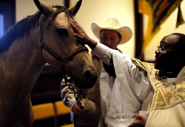 The Rev. Joseph Alsay blesses Sissy the horse as Michael West looks on during a  Blessing of the Animals service in honor of St. Francis of Assisi�s feast day at St. Augustine of Canterbury Episcopal Church in Oklahoma City. PHOTOS BY SARAH PHIPPS, THE OKLAHOMAN
